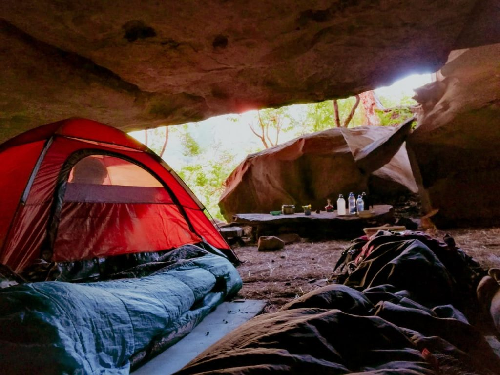camping in a tent under rocks